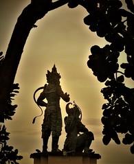the warriors (SM Tham) Tags: asia southeastasia indonesia bali island nusadua nusagede park tree statues rama lakshmana ramayana evening sunset outdoors monochrome warriors bowandarrows bronze