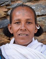 Tigray Woman (Rod Waddington) Tags: africa african afrique afrika äthiopien ethiopia ethiopian ethnic etiopia ethnicity ethiopie etiopian tigray village woman traditional orthodox female face outdoor stone rocks house building rockwork earing shamma people portrait