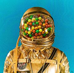 ag (woodcum) Tags: vending astronaut gum bubblegum color helmet suit cosmic gold retro vintage surreal woodcum grain collage portrait