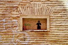 The man in the window (gerard eder) Tags: world travel reise viajes europa europe españa spain spanien städte city ciudades cityview cityscape stadtansicht street streetlife streetart strase valencia outdoor oldcity bricks brickwall