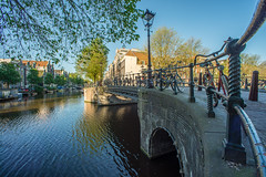 (angheloflores) Tags: amsterdam canal houses bridge lights water reflections city travel architecture urban explore netherlands brouwersgracht herengracht netherland sunrise colors clouds sky angelflores