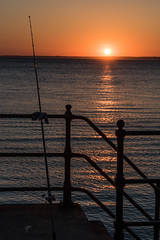 DSF_2084.jpg (alfiow) Tags: fishingrod railings sunset totland