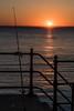 DSF_2084.jpg (alfiow) Tags: fishingrod railings sunset totland