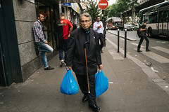 Paris, France (f.d. walker) Tags: europe france paris cane candidphotography candid color clothes colorphotography city streetphotography street strange funny weird bags walk walking man humor