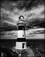 The Palliser Series #5 Lighthouse #2 (niggê) Tags: newzealand wairarapacoast northisland southernocean cookstrait tasmansea southpacificocean sonyilce7rm2 sony sonya7rii sonylens sony247028gm fe2470mmf28gm fe2470gm fishing surf beach lagoon wild shingle flotsam jetsam binkiebickerton cloudsstormssunsetssunrises mangatoetoe howlingwind squall lighthouse fresnel monochrome bw blackandwhite therebeastormabrewin