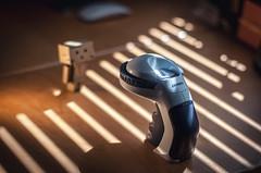 Danbo v Dymo (Matt_Briston) Tags: danbo dymo robot labelling machine 9mm tape desk light blinds matt cooper nikon d90 50mm