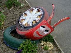 Tyre shell (Nekoglyph) Tags: seaham countydurham publicart garage tyre snail red wheel funny cute rubber metal treads
