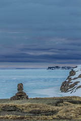 We were there when it melted-4598 (Mathieu Dumond) Tags: canada arctic nunavut kitikmeot kugluktuk spring may melt seaice blue water sky nature environment snow melting clouds colors drama inukshuk enokhok marker stones rocks mathieudumond umingmakproductionsinc outdoor inexplore