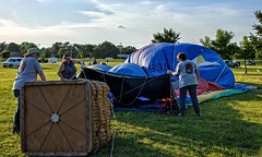 Balloon Inflation Process:  Starting to Blow (brev99) Tags: tulsa balloonfestival d610 balloonists crew basket perfecteffects17 ononesoftware on1photoraw2017 people field grass