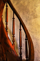 Gentle Curves (studioferullo) Tags: abstract architecture art beauty bright building city colorful colors contrast dark design detail downtown edge light minimalism old perspective pattern pretty scene serene tranquil study texture tone world santafe newmexico staircase stairs bannister handrail railing wood curve lines adobe stucco plaster brown ocher ochre spindle church sanctuary chapel guadalupe interior
