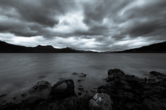 Curtain of Clouds... (_Amritash_) Tags: monsoon clouds rainclouds stormclouds landscape landscapes travel pawana lake maharashtra rocks stones water hills longexposure longexposurejunkie blackandwhite monochrome monochromatic monochromemadness selenium