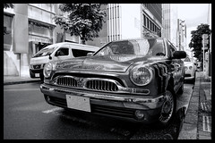 Tokyo Metropolitan Area: Impressions of a great city (Matthias Harbers) Tags: panasonic dmctx1 photoshop elements topaz tokyo metropolitan lumix zs100 tz100 living bw black white monochrome city street life impression blackandwhite photo border tree car classic japan british hdr photomatix 3xp ginza toyota toyotaorigin