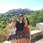Honors students Danielle Grady, Emma Pollock, and Jessica Grady pose with the Acropolis in the background on the Greece trip.
