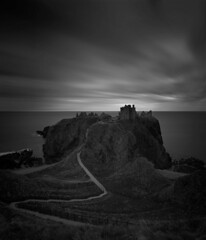 Dunnottar Castle (ShinyPhotoScotland) Tags: aberdeenshire anthropocene art beautiful blackandwhite calmstill castle clouds coast composite contrasts crazyart dark dcraw digitaldodgeburn digitalgmic digitalgradnd digitalvignette dramatic dulllight dunnottarcastle elegance emotion existentialist favourite filter geology gimp gloomy harmony hdr horizon hugin imposing landscape landwater light longexposure mankindnature monochrome nd1000 nearfar nisi northsea painteffects panorama pentaxk1 rockstone rugged ruin samyang24mmf14 sandstone scotland shapeandform skyearth stark stonehaven strange striking sumptuous timeflows timefulness toned tranquil turbulence vertorama vintage vista water