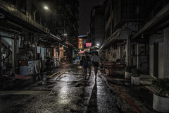 Ladies night, Taipei (urbanexpl0rer) Tags: asia taipei taiwan street road rain streetphotography night nightphotography dark moody people shadows