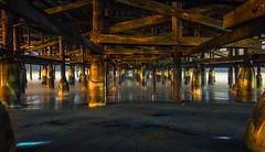 Beneath the Pier (Amazing Aperture Photography) Tags: ocean sea water night midnight longexposure pacific pacificocean pacificbeach pier crystalpier sandiego sonya6000 beneath below underneath dark beach tide architecture