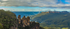 Three Sisters (Anthony Kernich Photo) Tags: threesisters rock cliff formation iconic view nsw australia newsouthwales panorama pano panoramic olympus photo photography travel scene scenic amazing wow beautiful attraction bluemountains katoomba echopoint mountain park icon famous lookout sydney stunning trees rocks sky olympusem10 olympusomd leura green landscape rayleighscattering natural nature breathtaking best flickr nationalpark