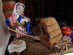 baking bread (SM Tham) Tags: africa morocco rifmountains chefchaouen thebluecity thebluepearl riadgharnata guesthouse bedandbreakfast moroccanart woman baker bread oven firewood