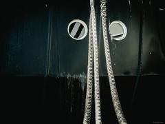 Ship Detail 1 - Sassnitz, Germany (Sebastian Bayer) Tags: norddeutschland mft deutschland sassnitz bullaugen micro43 ausflug seile hafen schiff dunkel rügen omdem5ii 124028 monoton olympus serie minimalistisch urlaub schiffahrt detail mecklenburgvorpommern de