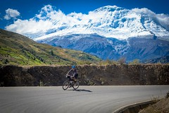 Andrew cycling with Huascaran mountain in the background.