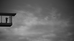 Human's dream was always to fly... (Michael Kalognomos) Tags: blackwhite canoneos5dmarkiii ef75300mmf456iii monochrome sky seagull clouds bw man balcony view snfccstavrosniarchosfoundationculturalcentre evening greece athens streetlife streetphotography bird minimal light