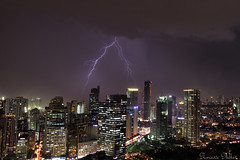 Light and darkness (Sumarie Slabber) Tags: lightning display night city weather storm clouds buildings manila philippines sumarieslabber photography bolts thunder