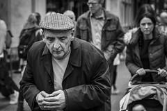 Clasped (Leanne Boulton) Tags: people monochrome portrait urban street candid portraiture streetphotography candidstreetphotography streetportrait candidportrait streetlife eyecontact man male old age aged elderly face facial expression look emotion feeling mood atmosphere cap hands gesture clasped tone texture detail depthoffield bokeh naturallight outdoor light shade shadow city scene human life living humanity society culture canon canon5d 5dmarkiii 70mm character ef2470mmf28liiusm black white blackwhite bw mono blackandwhite glasgow scotland uk