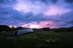 Clouds (Arvid Björkqvist) Tags: clouds sky evening beautiful blue purple pink boat grass green flowers stranded sweden storm wind colors