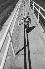 on our way to the park (L. Paul) Tags: pentaxk1000 pentax28mmf28 28mm blackandwhitefilm film filmshooter ishootfilm ilforddelta400 orangefilter circularpolarizer
