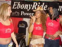 Ebony Rider Girls at their booth.  Angela White on the left. (hootervillefan) Tags: ims international motorcycle show ebony rider ebonyrider ebonyridermagazine busty babes tight red tank top angela white angelawhite