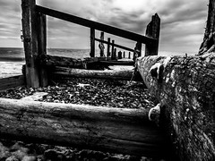 maryport old (joeanthonyhill) Tags: beach sea shore pier waves water longexposure blackandwhite monochrome wood broken old coast cumbria grey dark sky overcast cloud rocks jetty weldingglass budget