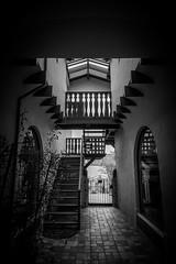 Stairs (Rohit KC Photography) Tags: carmel carmelbythesea canon5dmarkii canon24105mmf4l blackandwhite bw edited lightroom vignette usa california ca dark roadtrip ceiling