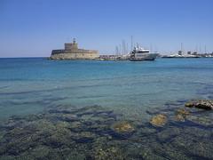 The clear waters of Mandraki harbour (ORIONSM) Tags: rhodes greece harbour mandraki water clea ocean sea rocks landscape nature olympus omdem1