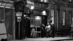 nocturnal street scene (byronv2) Tags: nocturnal street candid peoplewatching bar pub thomsonsbar morrisonstreet haymarket westend edinburgh edimbourg blackandwhite blackwhite bw monochrome edinburghbynight scotland night nuit nacht
