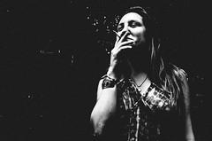 behind a cigarette (matthias hämmerly ..OFF FOR A WHILE...) Tags: candid street streetphotography shadow contrast grain ricoh gr black white bw monochrom monochrome city town urban blackandwhite strasse people monochromphotography einfarbig personen silhouette zuerich woman swiss switzerland dark girl smoking smoker night summer