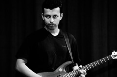 The guitar boy... (bappadityachandra) Tags: people performance person stage black white guitar expression mood attitude