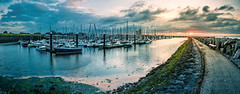 Sunset at Breskens harbor (FotoartDH) Tags: hafen breskens holland niederlande zeeland nordsee yachten yacht yachthafen boote boot segelboot segelboote segelschiff segelschiffe meer hafenbecken wasser sonnenuntergang sonne wolken panorama steg bootssteg steine deich rot orange schön abendrot wolkenfront netherlands europe northsea north sea ocean water harbor harbour docks sailing boat sailboat sailingboat marina dusk sunset afterglow red blue photography clouds cloudfront weather reflections danielheine