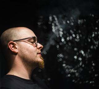 Smoke between dark an bokeh