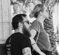 Tattooed man and girlfriend on corner (LarryJay99 ) Tags: facialhair couple goatee profile two man tattoos beards male men mustache tatts face canonefs18135mmf3556is