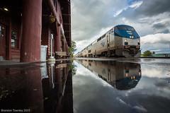 Empire Builder in East Glacier, MT (Brandon Townley) Tags: trains railroad amtrak mariaspass train empirebuilder reflection passengertrain