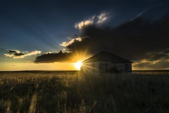 Leader Church (Tom Herlyck) Tags: america contrast scenic colorful colorado leaderchurch sunset southeastcolorado sky southeasterncolorado shortgrassprairie amazing beautiful prairie pikespeak greatamericandesert goldenlight southerncolorado decaying flickr godbeams rural sunshine
