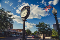 Downtown Granite Falls, Minnesota - Prentice Street (Tony Webster) Tags: america americanflag downtown granitefalls minnesota prenticestreet clock smalltown unitedstates us wmc1830