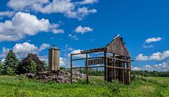 broken down (Brian Kermath (e.h.designs)) Tags: oldbarn barn silo fallendown fallingdown decay abandoned derelict ruraldecay farm oldfarm wisconsin debrispile debris clouds sky waukauwisconsin wsicosnin rushfordwisconsin oshkoshwisconsin