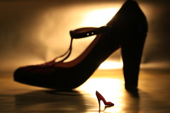 Dancing queen (alideniese) Tags: shoes closeup stilllife silhouette light shadow bokeh small large perspective 7dwf crazytuesdaytheme crazyanduniqueperspective alideniese colour pink red gold dollsshoe barbieshoe