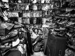 Anywhere will do 😴..... (-Faisal Aljunied - !!) Tags: leather shop shoes luggages handbags blackandwhitestreet tired sleeping china guangzhou iphone7plus streetphotography faisalaljunied