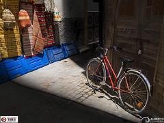 Between shadows (Alesfra) Tags: alesfra alesfrafotografia alesfraphotography alesfracom em1 essaouira foto marrakech marruecos mirrorless morocco olympus olympusem1 olympusomdem1 omd photo sinespejo tamron tamron14150mmf3558diiii wwwalesfracom africa bike bicicleta bicycle shadow sombra luz light triángulo bag bolso albertojespiñeirafrancés sport street calle color door puerta medina zoco mercado wheel rueda ride trip viaje estera alfrombra carpet mat suelo concrete bici composition composición sunlight blue azul wall pared muro