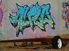 Tag and Wheel (mikecogh) Tags: wingfield graffiti colorful colourful publicart mystery axle urbex wheel junk rubbish tag