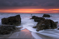 down the middle (Andy Kennelly) Tags: malibu sunset rocks beach pacific ocean waves reflections light california pch