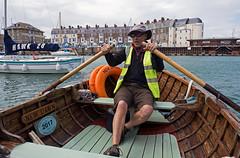 170607 Weymouth Ferry DSC9031 (stevebell) Tags: weymouth dorset weymouthharbour ferry passengerferry passengervessel rowingboat newdawn rower oars sea water harbour yacht hawk20 harbourside costal coast coastalresort seasideresort portrait environmentalportrait rowing woodenboat dorsetcoast