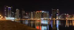 Bahrain at night (Clicks by Mike) Tags: reflection water manama juffair bahrain illuminated buildings travel night cityscape nikon d7100